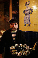 French Oysterman in Paris Restaurant --- Image by &copy; Owen Franken
