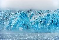 Fog over Surprise glacier, Harriman Fjord, Prince William Sound, Alaska.