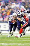 New England Patriots quarterback Tom Brady (12) rushes for yardage behind the blocking of guard Stephen Neal (61) against the Buffalo Bills at Ralph Wilson Stadium in Orchard Park, NY, on December 11, 2005 . The Patriots defeated the Bills 35-7. Mandatory Photo Credit: Ed Wolfstein
