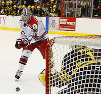 Ryan Dzingel of OSU shoots on Michigan goalie Steve Racine in the third period at Value City Arena in Columbus Dec. 2, 2013.