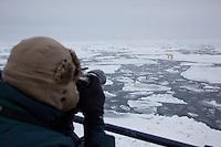 Photographer and polar bear (Ursus maritimus), Svalbard, Norway.
