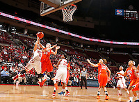 Ohio State's Cait Craft (13) scores against Illinois Jaqui Grant (34) in the first half of their game against the Illinois Fighting Illini at the Value City Arena in Columbus, Ohio on January 30, 2014. (Columbus Dispatch photo by Brooke LaValley)