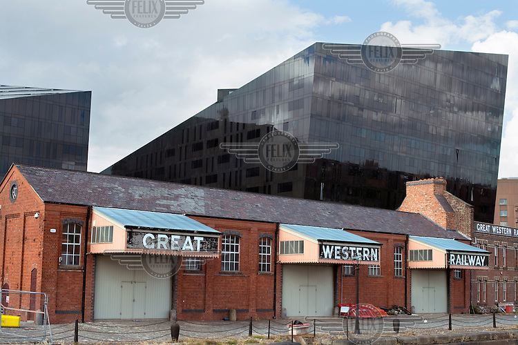 The Great Western Railway Warehouse and Office, North of the Canning Graving Docks, Liverpool. Behind is one of the the Mann Island Buildings.