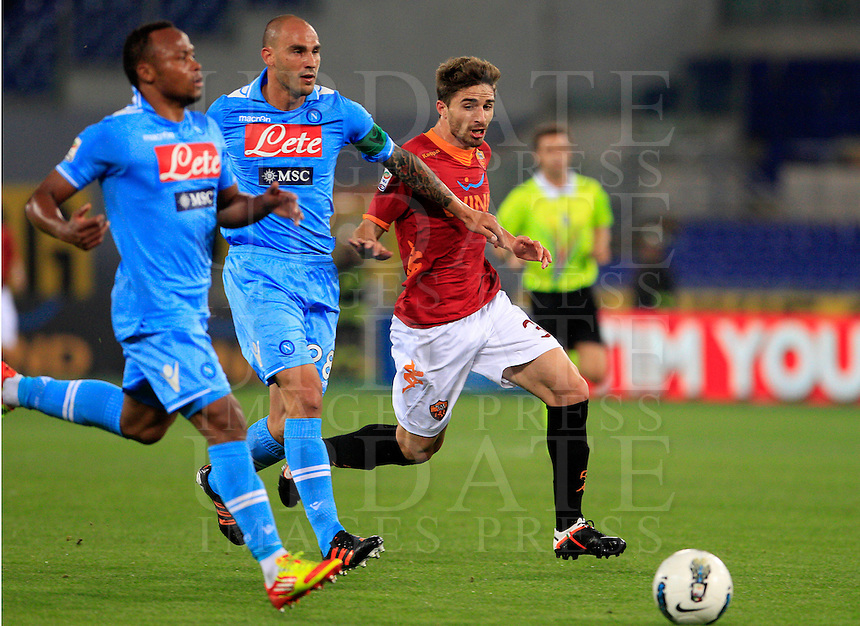 Calcio, Serie A: Roma-Napoli. Roma, stadio Olimpico, 28 aprile 2012. L'attaccante della Roma AS Roma forward Fabio Borini, a destra, inseguito dal centrocampista colombiano del Napoli Juan Camilo Zuniga, a sinistra, e dal difensore Paolo Cannavaro..AS Roma forward Fabio Borini, right, is chased by Napoli defender Paolo Cannavaro, center, and midfielder Juan Camilo Zuniga, of Colombia, during the Italian Serie A football match between AS Roma and Napoli, at Rome Olympic stadium, 28 april 2012..UPDATE IMAGES PRESS/Riccardo De Luca