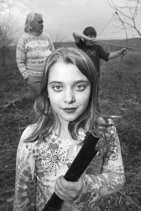 A Young Girl with a Gun and her Grandmother and Brother Squirrel Hunting
