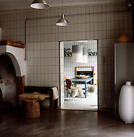 The ground floor kitchen and dining area was converted from a butcher's shop and still has the original wall tiles