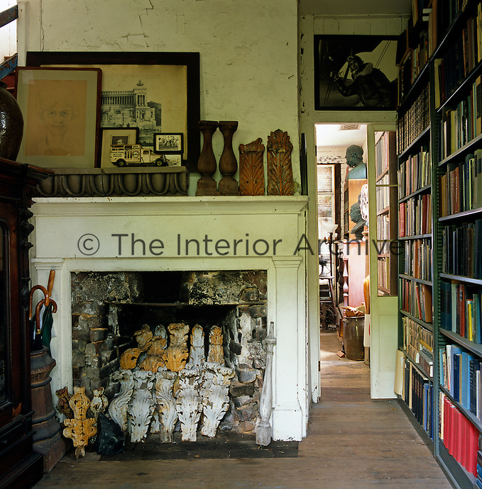 The disused fireplace in the study is filled with a collection of architectural mouldings