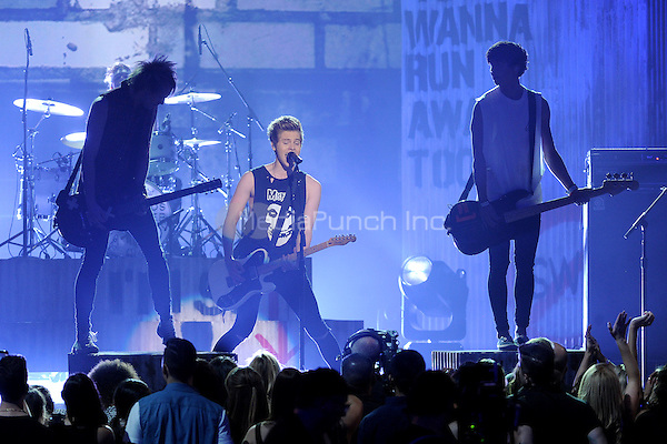 LAS VEGAS, NV - MAY 18: 5 Seconds of Summer performs on the 2014 Billboard Music Awards at the MGM Grand Garden Arena on Sunday, May 18, 2014 in Las Vegas, Nevada. PGMicelotta/MediaPunch