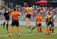 BOYDS, MARYLAND-JULY 07,2012:  Marisa Abegg (5) of DC United Women heads past Briana McConnell (15) of Dayton Dutch Lions during a W League game at Maryland Soccerplex, in Boyds, Maryland. DC United women won 4-1.