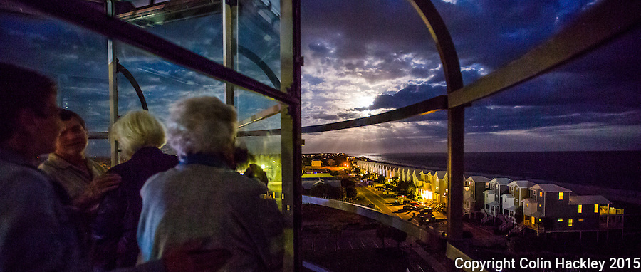 St. GEORGE ISLAND, FLA., 11/25/15-Visitors to the lighthouse on St. George Island, Fla. watch the full moon rise over the eastern end of the island. The lighthouse offers special tours every month on the day that the sunset and full moon rise coincide. <br /> <br /> COLIN HACKLEY PHOTO