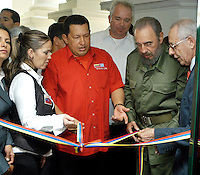 President of Venezuela Hugo Chavez, (left), the Cuban President Fidel Castro, they cut the tape of entrance of the offices of PDVESA, April 28, 2005. Castro joined Chavez AT the opening of the South oil American nation's new company office in Cuba ace the leftist leaders to further integrated to their economies and promoted to hemispheric trade pact that would exclude the United States. Credit: Jorge Rey/MediaPunch
