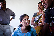 A teenage girl looks at her cousin as he explains her medical problem to the visiting doctor at the local hospital in Chalisgaon, Maharashtra, India. Rotary Club organises a free medical camp for the poor and needy. India's leading Micro and plastic surgeons visit the medical camp and provide free medical service.