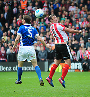 Lincoln City's Matt Rhead vies for possession with Macclesfield Town's George Pilkington<br /> <br /> Photographer Andrew Vaughan/CameraSport<br /> <br /> Vanarama National League - Lincoln City v Macclesfield Town - Saturday 22nd April 2017 - Sincil Bank - Lincoln<br /> <br /> World Copyright &copy; 2017 CameraSport. All rights reserved. 43 Linden Ave. Countesthorpe. Leicester. England. LE8 5PG - Tel: +44 (0) 116 277 4147 - admin@camerasport.com - www.camerasport.com