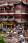 People with umbrellas in the Old City of Shanghai, China 2014