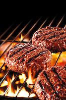 Flame grilled burger on a bbq food photos.