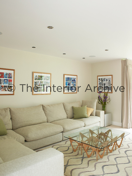 A large L-shaped sofa and a patterned rug furnish the contemporary living room