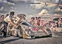The #67 Porsche 962 of Bob Wollek, Derek Bell, and John Andretti is pushed by crewmen to vicotry lane after winning the SunBank 24 at Daytona, Daytona International Speedway, Daytona Beach, FL, February 5, 1989.  (Photo by Brian Cleary/www.bcpix.com)