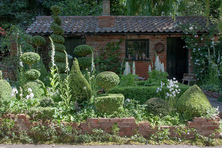 The Topiarist Garden, silver gilt medal winner in the artisan garden section at the Chelsea Flower Show, 2014. Designed by Marylyn Abbott and inspired by the remains of the historic bothy and courtyard garden at her home, West Green House, Hampshire.