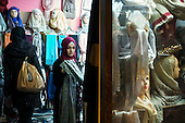 People shop in Brussels' Molenbeek neighbourhood, a hotbed of Islamic radicalism.
