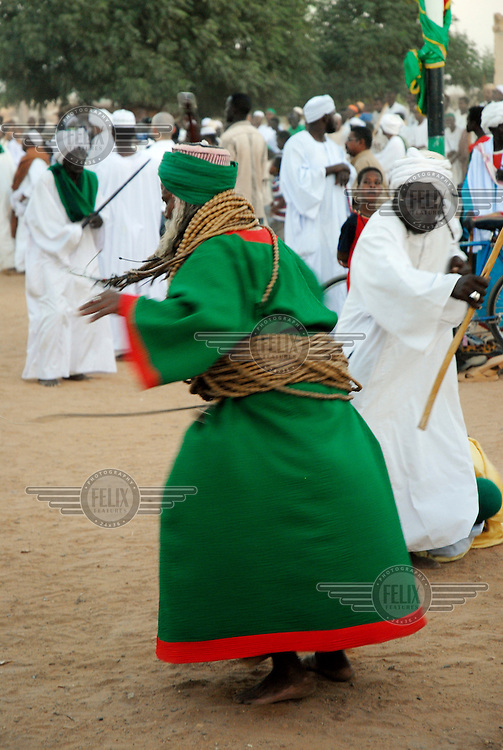 Each Friday, men gather an hour before sunset in front of Hamed al-Nil mosque in Omdurman where Sufi muslims form a huge circle. As the crowd sings and chants praises to Allah, the drums beat a rhythm and the 'whirling dervishes' begin to whirl.