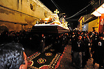 During colorful &quot;Semana Santa&quot; (Saints week) in Antigua, Guatemala   luxurious alfombras  adorn the cobbled streets between processions.  Families and friends begin preparations weeks and months ahead of the festival to create these vibrant and intricately patterned carpets.  They are made of dyed sawdust in hues of black, red, yellow, purple, blue, and green.  They are pressed through intricately designed cardboard stencils.  Flowers, seeds, plants, vegetables, and pine needles add the final touches to these temporary works of art.  The carpets' designs reflect biblical symbols, Mayan traditions, and scenes from nature.   The beautiful carpets are trampled by the processions, as a way to honor Christ's death.<br /> <br /> Antigua, a colonial town, is a UNESCO World Heritage site.