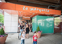 The kick-off of the annual Vendy Plaza at  La Marqueta in the East harlem neighborhood of New York on Sunday, May 24, 2015. The plaza area, La Marqueta Retoña, hosts a weekly vendors market drawing on food entrepreneurs from the streets around the city. (© Richard B. Levine)