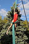 Bellmore, New York, U.S. 22nd September 2013. ROBIN LYNCH, aerialist from Valhalla, Westchester, performs hanging from aerial silk at the 27th Annual Bellmore Festival, featuring family fun with exhibits and attractions in a 25 square block area, with over 120,000 people expected to attend over the weekend.