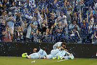 Sporting KC players celebrate late goal..Sporting Kansas City defeated D.C Utd 1-0 at Sporting Park, Kansas City, Kansas.