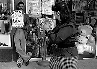 A striking worker protests against starvation wages at Edworks, a large shoe chain. In the dying days of the apartheid government, the labour unions flexed their muscles through a number of strikes calling for better conditions for black workers.