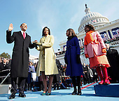 Washington, DC - January 20, 2009 -- United States President Barack Obama takes the oath as the 44th U.S. President with his wife, Michelle, by his side at the U.S. Capitol in Washington, D.C., Tuesday, January 20, 2009. Daughters Malia, center right, and Sasha, right, look on..Credit: Chuck Kennedy - Pool via CNP