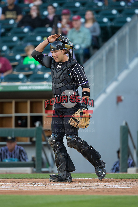 Charlotte Knights catcher Kevan Smith (32) on defense against the Norfolk Tides at BB&T BallPark on May 2, 2017 in Charlotte, North Carolina.  The Knights defeated the Tides 8-3.  (Brian Westerholt/Four Seam Images)
