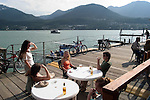 Alaska, Juneau: Dining in Juneau on the wharf and at the Hangar On The Wharf in front of the float plane dock. .Photo #: alaska10125 .Photo copyright Lee Foster, 510/549-2202, lee@fostertravel.com, www.fostertravel.com.