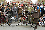 The Tweed Run London UK. Steps of Albert Hall. Interview with Jacqui, organiser in tweed centre next to man in bowler hat.