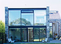 The rear of the property is constructed almost entirely of glass