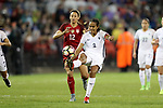 WASHINGTON, DC - MARCH 07: Wendie Renard (FRA) (3) clears the ball away from Lynn Williams (USA) (12). The United States Women's National Team hosted the France Women's National Team as part of the SheBelieves Cup on March 7, 2017, at RFK Stadium in Washington, DC. France won the game 3-0.