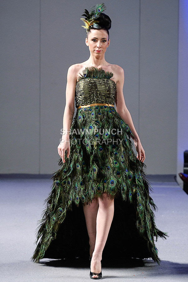 Model walks runway in an outfit from the LeGair Brand collection by Arthlene Laudat Legair, during Couture Fashion Week New York Spring 2013, on September 17, 2012.