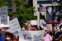 "Washington, D.C., April 15, 2010 - A man wearing an Obama mask rallies with fellow Tea Party supporters during at a rally for the People's Tax Revolt at Freedom Plaza hosted by ResistNet.com and the Tea Party Express, which concluded its 43-city tour across the country with this rally on Tax Day. Many carried signs of protest against the Congress and President Obama, who many accuse of being a communist and a socialist. The Tea Party Express tour titled ""Just Vote Them Out"" has taken an aggressive approach by targeting Democratic incumbents competitive districts, as well as Republicans deemed not conservative enough who are facing primary challenges from more conservative candidates. While not endorsing any candidates so far, the Tea Party Express does not hide its desire to replace incumbents with new conservatives that more closely hew to its goals of smaller government and less taxes..."