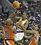 Seattle SuperSonics Ray Allen ,center, looks to pass the ball off while being guarded by  Los Angeles Clippers Sam Cassell,left, and Shaun Livingston in the third period on Friday, April 14, 2006 at the Key Arena in Seattle. The Clippers beat the SuperSonics 101-97.  Jim Bryant Photo. &copy;2010. All Rights Reserved.