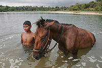 Portrait of a local boy with his horse near the village of Wainyapu, Western Sumba.