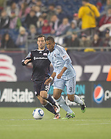 Sporting Kansas City forward Teal Bunbury (9) dribbles as New England Revolution defender A.J. Soares (5) pressures. In a Major League Soccer (MLS) match, the New England Revolution defeated Sporting Kansas City, 3-2, at Gillette Stadium on April 23, 2011.