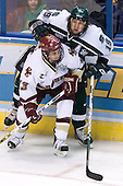 Pat Gannon (Boston College - Arlington, MA) slows up Chris Mueller (Michigan State - West Seneca, NY) on the boards. The Michigan State Spartans defeated the Boston College Eagles 3-1 (EN) to win the national championship in the final game of the 2007 Frozen Four at the Scottrade Center in St. Louis, Missouri on Saturday, April 7, 2007.