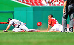 29 August 2010: Washington Nationals infielder Justin Maxwell slides safely into second during game action against the St. Louis Cardinals at Nationals Park in Washington, DC. The Nationals defeated the Cards 4-2 to take the final game of their 4-game series. Mandatory Credit: Ed Wolfstein Photo