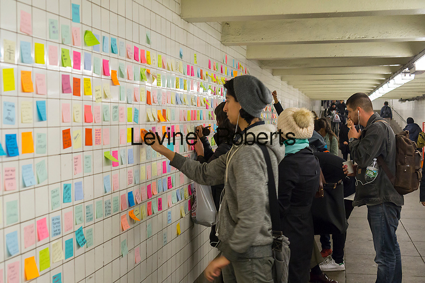 "Thousands of travelers write their thoughts about the results of the presidential election on post-it notes as part of the ""Subway Therapy"" project by Matthew Chavez in the subway in New York, seen on Tuesday, November 15, 2016. Chavez started the project to enable New Yorkers to vent their emotions on the election of Donald Trump. Many wrote angry messages and some wrote messages of hope and some now felt they were not alone and part of a community. (© Richard B. Levine)"