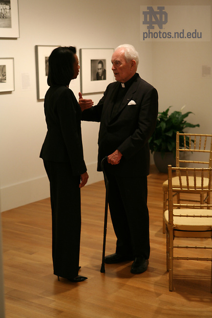 United States Secretary of State Condoleeza Rice and Notre Dame President Emeritus Rev. Theodore Hesburgh chat during a 90th birthday celebration for Fr. Hesburgh at the Smithsonian Institution's National Portait Gallery in Washington D.C.  Photo by Matt Cashore