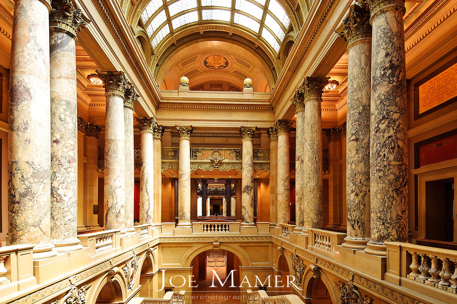 Interior of the Minnesota state capitol. The building was designed by Cass Gilbert. The unsupported dome is the second largest in the world, after Saint Peter's. Work began in on the capitol in 1896, and construction was completed in 1905. It is the third building to serve this purpose: the first capitol was destroyed by fire in 1881, and the second was completed in 1883, but was considered to be too small almost immediately..