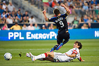 Dejan Jakovic (5) of DC United fouls Jack McInerney (9) of the Philadelphia Union. DC United defeated Philadelphia Union 1-0 during a Major League Soccer (MLS) match at PPL Park in Chester, PA, on June 16, 2012.