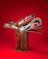 Four-faced Hamat'sa Mask, c. 1938, by George Walkus, Canadian, c. 1890-1950, made from wood, paint, string and cedar bark, bought through the Native Arts Acquisition Fund, in the Denver Art Museum, Denver, Colorado, USA. Native Americans on the North West Coast use masks in feasts called potlatches, held to celebrate clan status. This mask represents a bird monster called Galokwudzuwis, or Crooked Beak, and is worn by a member of the Hamat'sa Society. Above the crooked beak is the head of a crane, while two raven heads project from the back of the mask. By pulling strings, parts of the mask move to create sound and movement during the dance. Picture by Manuel Cohen