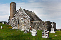 Low angle view of Temple Connor, 1010, by Cathal O'Conor, and O' Rourke's Tower, Clonmacnoise, County Offaly, Ireland, in the evening. Clonmacnoise was founded by St Ciaran, with the help of Diarmait Ui Cerbaill, Ireland's first Christian King. The site presents the largest collection of Early Christian graveslabs in Western Europe. Picture by Manuel Cohen