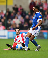 Macclesfield Town's Rhys Browne is tackled by Lincoln City's Sam Habergham<br /> <br /> Photographer Chris Vaughan/CameraSport<br /> <br /> Vanarama National League - Lincoln City v Macclesfield Town - Saturday 22nd April 2017 - Sincil Bank - Lincoln<br /> <br /> World Copyright &copy; 2017 CameraSport. All rights reserved. 43 Linden Ave. Countesthorpe. Leicester. England. LE8 5PG - Tel: +44 (0) 116 277 4147 - admin@camerasport.com - www.camerasport.com