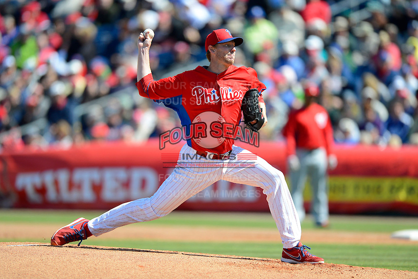 Philadelphia Phillies pitcher Roy Halladay #34 delivers a pitch during a Spring Training game against the Washington Nationals at Bright House Field on March 6, 2013 in Clearwater, Florida.  Philadelphia defeated Washington 6-3.  (Mike Janes/Four Seam Images)